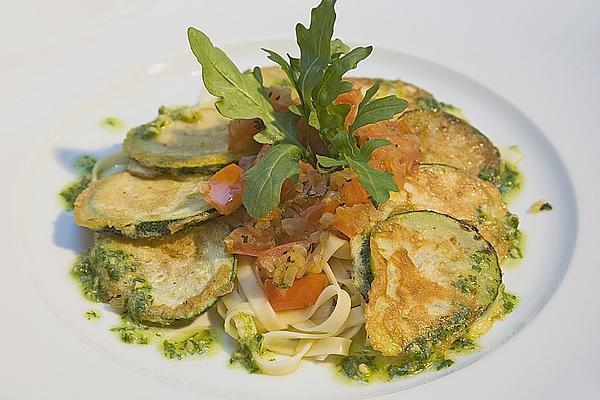 Zucchini – Piccata on Tomato Compote with Rocket Pesto and Noodles
