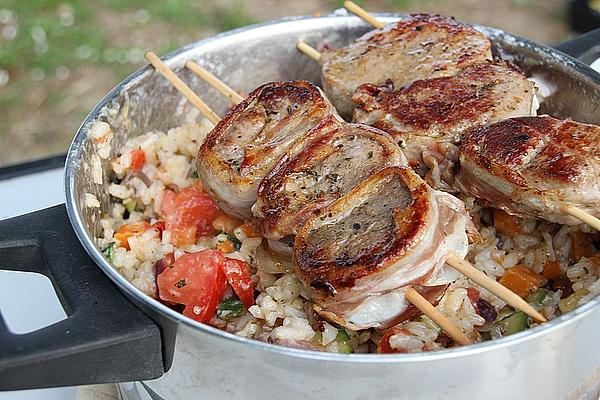 Pork Loin Wrapped in Bacon on Vegetable Risotto